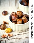 Roasted Chestnuts In Bowls On...
