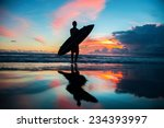 Young Surfer With Board On The...