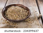 heap of spelt on dark wooden... | Shutterstock . vector #234399637