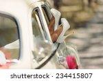 bride's feet in white wedding...   Shutterstock . vector #234415807