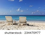 two white deckchairs at... | Shutterstock . vector #234470977