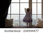 a girl standing near the window ... | Shutterstock . vector #234544477