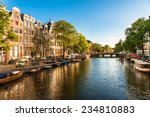 Houses And Boats On Amsterdam...