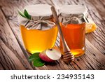 glass cans full of honey and... | Shutterstock . vector #234935143
