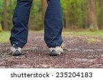 man's boots. walking in a... | Shutterstock . vector #235204183