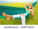 Carefree Woman Relaxing In A...