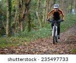 cyclist on a mountain bike...   Shutterstock . vector #235497733