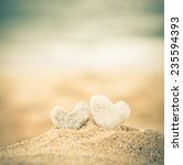 Two Coral Hearts On A Beach In...