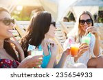 happy girls with beverages on... | Shutterstock . vector #235654933