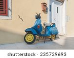 old blue scooter parked by the... | Shutterstock . vector #235729693