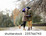 young beautiful couple kissing... | Shutterstock . vector #235766743