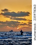 Man Fishing In The Sea Or Ocea...