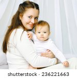 portrait happy mother and baby... | Shutterstock . vector #236221663