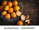 Tangerines On Vintage Plate.