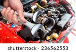 hand of car mechanic with... | Shutterstock . vector #236562553