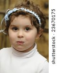 smiling young flower girl at a...   Shutterstock . vector #23670175