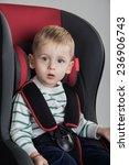 little boy in a a car seat | Shutterstock . vector #236906743