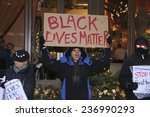 """Small photo of NEW YORK CITY - DECEMBER 10 2014:Picture the Homeless, an advocacy group, staged a rally against the """"broken windows"""" philosophy & NYPD commissioner William Bratton in front of the Manhattan Institute"""