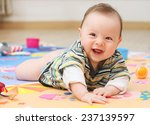 cute baby playing on a colorful ... | Shutterstock . vector #237139597