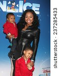 "Small photo of LOS ANGELES - DEC 11: Phaedra Parks, sons Ayden, Dylan at the ""Disney on Ice"" Red Carpet Reception at the Staples Center on December 11, 2014 in Los Angeles, CA"