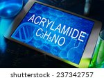 Small photo of the chemical formula of Acrylamide on a tablet with test tubes