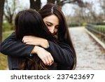 girl hugging her best friend  | Shutterstock . vector #237423697