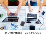two workmates teaming up and... | Shutterstock . vector #237547333