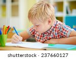 little schoolboy writing in... | Shutterstock . vector #237660127