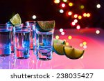 tequila and lime on a glass... | Shutterstock . vector #238035427