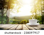 Stock photo cup with tea on table over mountains landscape with sunlight beauty nature background 238097917