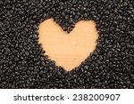 Black beans with wooden  heart shape space at center