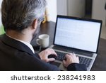 business man at home using a...   Shutterstock . vector #238241983