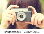 taking photos with film camera | Shutterstock . vector #238242013