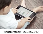child holding tablet computer... | Shutterstock . vector #238257847