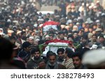Small photo of PESHAWAR, PAKISTAN - DEC 17: (JI) Ameer, Siraj Haq and other mourners attend a funeral ceremony of victims of an attack by militants on Army Public School on December 17, 2014 in Peshawar.