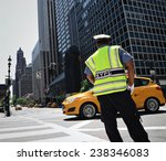 Nypd Officer Directing Traffic...