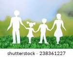 paper family on green grass on... | Shutterstock . vector #238361227