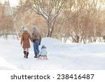 Young Parents Walking In Winte...