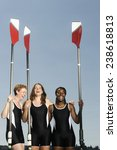 Small photo of Racing Boat Crew Holding Oars
