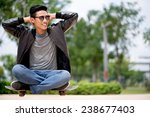young man sitting on the... | Shutterstock . vector #238677403