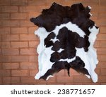 cow leather on a brick wall | Shutterstock . vector #238771657