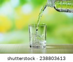 pouring water from bottle on ... | Shutterstock . vector #238803613