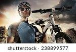 Sport. Cyclist Carry A Bike On...
