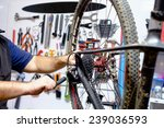 bicycle mechanic in a workshop... | Shutterstock . vector #239036593