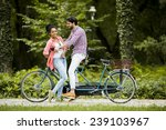 young couple riding on the... | Shutterstock . vector #239103967