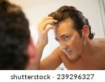 middle aged man concerned with... | Shutterstock . vector #239296327