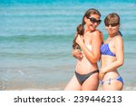 young happy girls laughing near ... | Shutterstock . vector #239446213