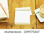 notebook  and coffee on wooden... | Shutterstock . vector #239575267