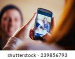 lovely couple in cafe taking... | Shutterstock . vector #239856793