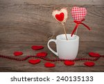 cup of coffee with hearts on a... | Shutterstock . vector #240135133